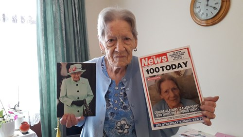Ellen Parry poses with her card from the Queen